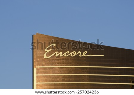 Las Vegas - November 11, 2014: The sun reflects off the golden windows of the Encore part of the Wynn Hotel and Casino on the Las Vegas Strip, - stock photo