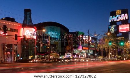 LAS VEGAS, NV - FEBRUARY 17:  Neon lights and traffic on the Las Vegas Strip in the early morning, just days before a shootout that killed three - Las Vegas, NV - February 17, 2013. - stock photo
