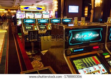 LAS VEGAS, NV- JULY 13, 2013:  Bellagio Casino's slot machines room. - stock photo