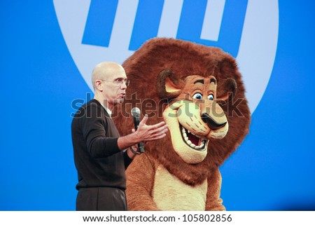 LAS VEGAS, NV - JUNE 5, 2012: DreamWorks Animation CEO Jeffrey Katzenberg delivers an address to HP Discover 2012 conference with cartoon character lion on June 5, 2012 in Las Vegas, NV - stock photo