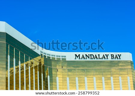 LAS VEGAS, NV -  JUNE 11, 2013:  The Mandalay Bay Resort and Casino in Las Vegas on June 11, 2013. Mandalay Bay with gold colored exterior was opened in 1999.  - stock photo