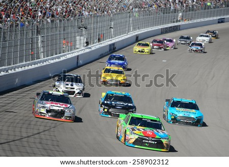 LAS VEGAS, NV - March 08: David Ragan leads a pack of cars into turn 1 at the NASCAR Sprint Kobalt 400 race at Las Vegas Motor Speedway on March 08, 2015 - stock photo