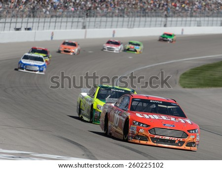 LAS VEGAS, NV - March 08: Greg Biffle (16) leading a pack of cars at the NASCAR Sprint Kobalt 400 race at Las Vegas Motor Speedway on March 08, 2015 - stock photo