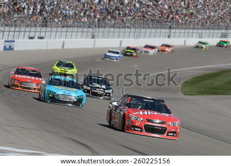 LAS VEGAS, NV - March 08: Regan Smith (41) leading a pack of cars at the NASCAR Sprint Kobalt 400 race at Las Vegas Motor Speedway on March 08, 2015 - stock photo