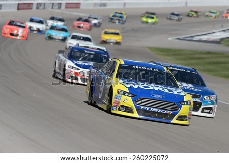 LAS VEGAS, NV - March 08: Sam Hornish Jr leading a pack of cars a the NASCAR Sprint Kobalt 400 race at Las Vegas Motor Speedway on March 08, 2015 - stock photo