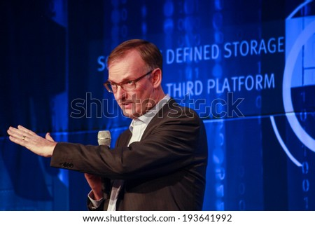 LAS VEGAS, NV -?? MAY 5, 2014: CEO EMC Information Infrastructure David Goulden makes speech at EMC World 2014 conference on May 5, 2014 in Las Vegas, NV  - stock photo