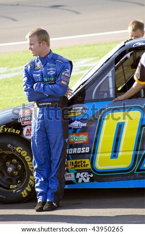 LAS VEGAS, NV - SEPTEMBER 26: Chad McCumbee waits patiently by his Tiwi / Aerus number 7 Chevrolet during qualifying of Sept. 26, 2009 Las Vegas 350. - stock photo