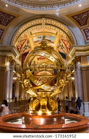 Las Vegas, NV, USA -circa  July 2013: People walking around the lobby fountain famous sculpture inside The Venetian hotel. - stock photo