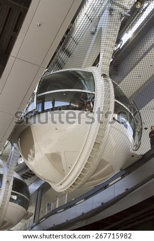 Las Vegas, NV, USA - March 24, 2015 : Tourist loading into the cars of the High Roller ferris wheel on the strip in Las Vegas