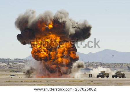 Las Vegas, NV, USA - November 9, 2014: Explosions as part of a demonstration at Nellis Air Force Base, Aviation Nation 2014 airshow - stock photo