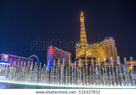 LAS VEGAS - OCT 05 : Night view of the dancing fountains of Bellagio and the Eiffel Tower replica of Paris hotel in Las Vegas Nevada, on October 05, 2016