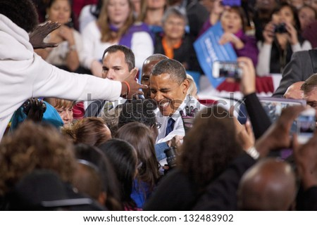 LAS VEGAS - OCTOBER 24: Barack Obama among his supporters at a rally at Doolittle Park on October 24, 2012 in Las Vegas, Nevada - stock photo