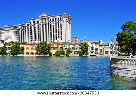 LAS VEGAS - OCTOBER 12: Caesars Palace Hotel from Bellagio's lake on October 12, 2011 in Vegas. Caesars has 3349 rooms and its casino is the only in Vegas to host a World Series of Poker Circuit Event - stock photo