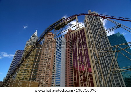 LAS VEGAS - SEP 7: A roller coaster soars past the replica Chrysler building at the New York, New York resort hotel on September 7, 2007 in Las Vegas, NV. - stock photo