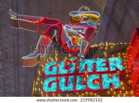 LAS VEGAS - SEP 14 : Cowgirl neon sign in downtown Las Vegas on September 14 2014. The iconic sign of Glitter Gulch is placed in 20 East Fremont Street, in Downtown Las Vegas - stock photo