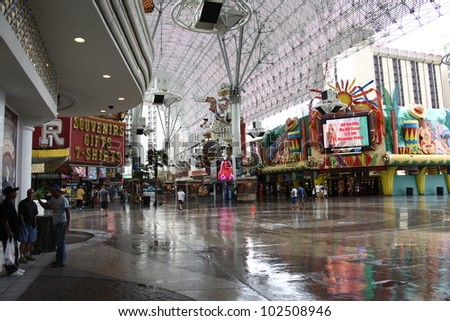 LAS VEGAS - SEPTEMBER 17: The Fremont Street Experience on September 17, 2008 in downtown Las Vegas, Nevada. The canopy is 90 feet high at the peak and four blocks long. - stock photo