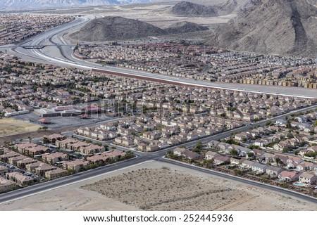 Las Vegas suburban housing sprawl adjoining the Spring Mountains in Southern Nevada. - stock photo