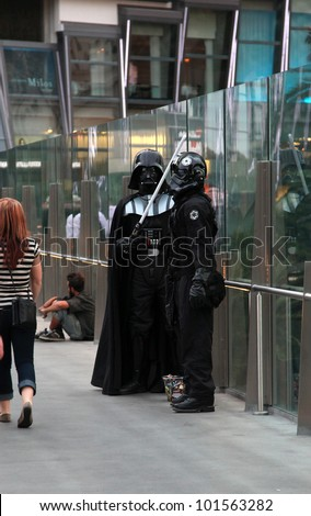 LAS VEGAS, USA - APRIL 25: Darth Vader and Storm Trooper impressionists in Las Vegas. 4th May is International Star Wars day. Word play on film quote: May the Fourth [force] be with you. 25 April 2012 - stock photo