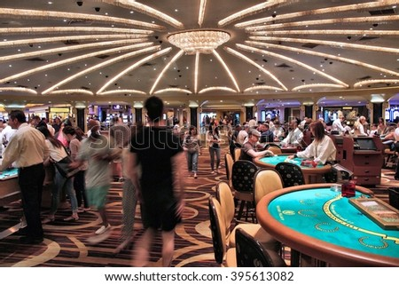 LAS VEGAS, USA - APRIL 14, 2014: People visit Caesar's Palace casino resort in Las Vegas. The famous casino resort has almost 4,000 rooms. - stock photo