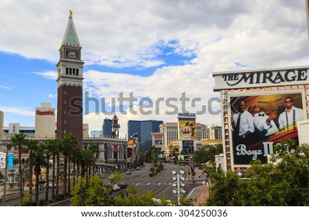 LAS VEGAS USA - JULY 6 2015: A panoramic view along Las Vegas Blvd showing some of the famous landmark hotels and casinos in Las Vegas. About 40 million people visiting the city each year.  - stock photo