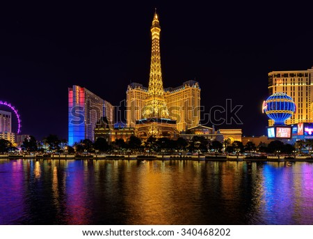 LAS VEGAS, USA - MARCH 26, 2015: Paris Las Vegas hotel and Casino March 26, 2015 in Las Vegas. The Paris hotel, Bellagio Fountains and the Eiffel Tower. - stock photo