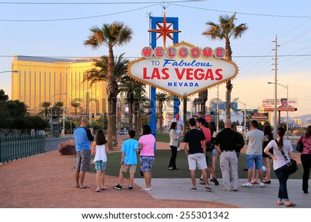 LAS VEGAS, USA - MARCH 19: Unidentified people stand near Welcome to Fabulous Las Vegas sign on March 19, 2013 in Las Vegas, USA. Las Vegas is one of the top tourist destinations in the world. - stock photo
