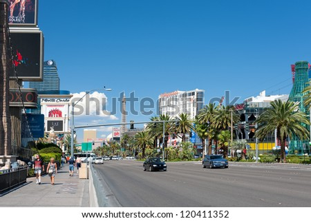 LAS VEGAS, USA - SEPTEMBER 21: People walking along The Las Vegas Strip on September 21, 2011 in Las Vegas. It is about 6.8 km (4.2 miles) section of Las Vegas Boulevard South in Clark County, Nevada - stock photo