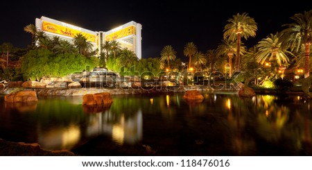 LAS VEGAS, USA - SEPTEMBER 21: Pond near The Mirage on September 21, 2011 in Las Vegas. Located on the Las Vegas Strip, The Mirage was opened in November 1989. - stock photo