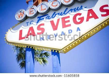 Las Vegas welcome sign with blue sky and palm tree