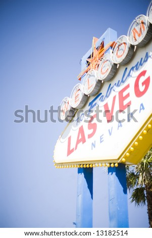 las vegas welcome sign with sky and palm tree in background - stock photo