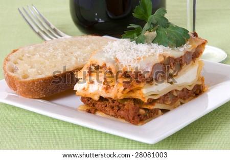 Lasagna and garlic toast with cabernet sauvignon - stock photo
