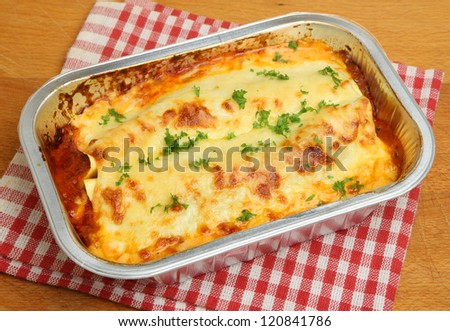 Lasagna convenience meal in foil tray - stock photo