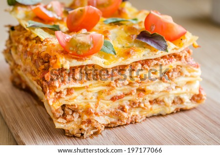 Lasagna with cherry tomatoes - stock photo