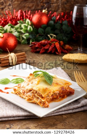 lasagna with tomato and bechamel sauce on complex background - stock photo