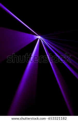 Laser beam purple on a black background