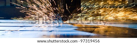 Laser cutting with sparks close up - stock photo