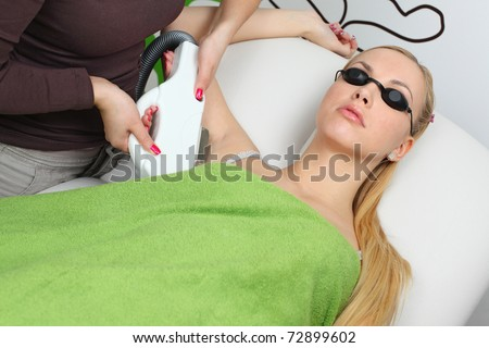 Laser hair removal in professional studio - stock photo