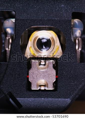 Laser head of DVD drive macro - stock photo