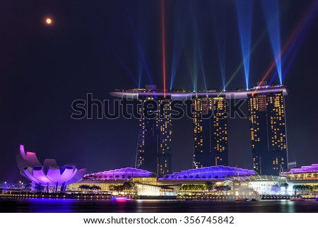 Laser lighting show over Singapore landmarks and tourist attraction. Colorful cityscape concept - stock photo