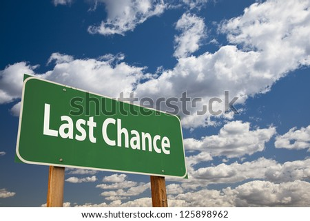 Last Chance Green Road Sign Over Clouds and Sky. - stock photo