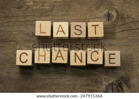 last chance text on a wooden blocks