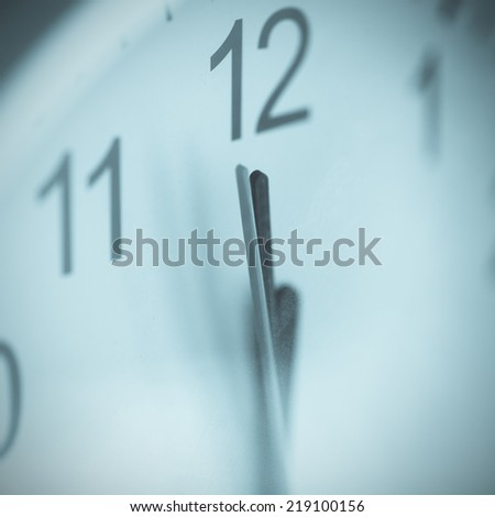 Last minute before deadline. There is some dust on glass of clock. Cross-processed image. - stock photo