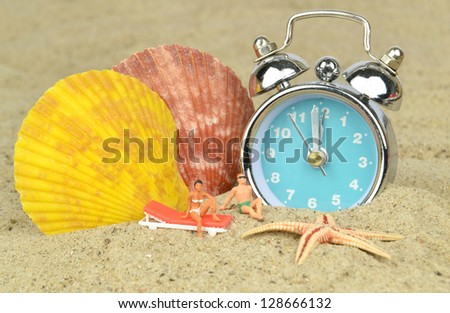 Last minute holiday concept with mini holiday makers relaxing next to a clock on the beach - stock photo
