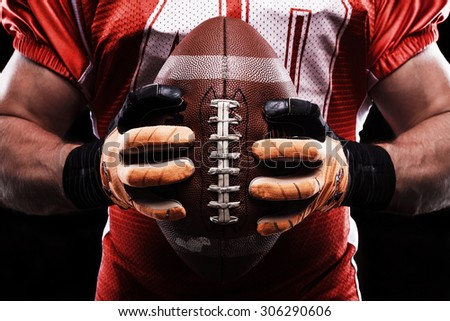 Last minute preparation. Close up of rugby ball in sportsmans hands holding it in front of him while going to play. - stock photo