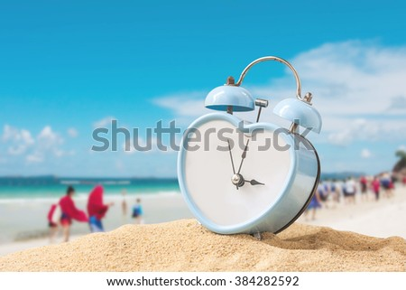 last minute to count down for travel metaphor by old retro clock on sand beach ,abstract background to time for summer vacation travel concept. - stock photo