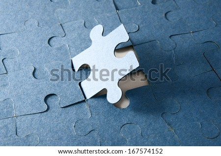 Last piece of jigsaw puzzle - blue tone - stock photo