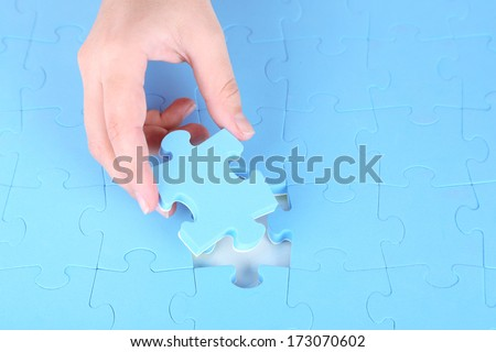 Last piece of jigsaw puzzle, close-up - stock photo