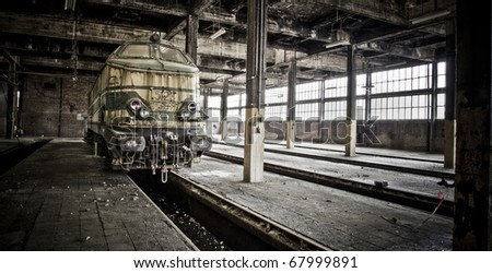 Last stop... This train never leaves this station again. Left behind at an old abandoned train workshop. - stock photo