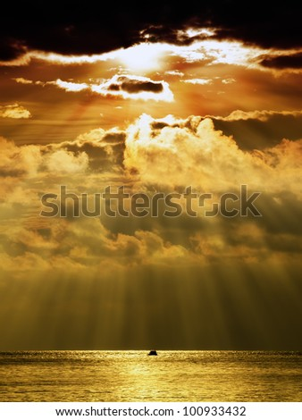 Last sun rays are falling on the horizon of the Adriatic sea under stormy clouds... - stock photo