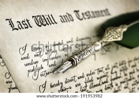 Last Will and Testament document with quill pen and handwriting - stock photo